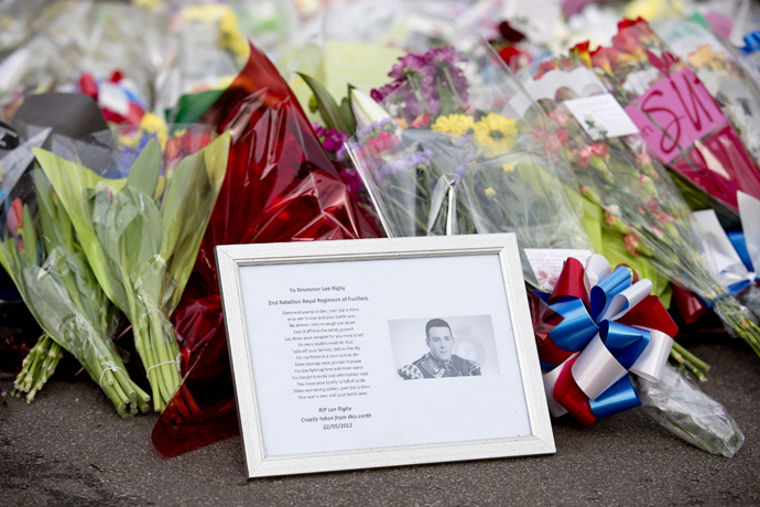 A framed photograph of Drummer Lee Rigby lies amongst floral tributes outside Woolwich Barracks in London on May 23, 2013, a day after the murder of a British soldier nearby (AFP Photo / Justin Tallis)
