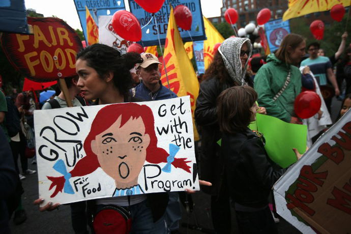 Protesters stage a demonstration outside a Wendy's restaurant on May 18, 2013 in New York City. The demonstrators called for the fast food chain to join Florida's Fair Food Program designed to improve wages for tomato pickers in the state. (AFP Photo / John Moore)