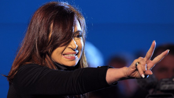 Argentine President Cristina Fernandez de Kirchner gestures to supporters at Plaza de Mayo square in Buenos Aires on May 25, 2013. (AFP Photo / Alejandro Pagni)