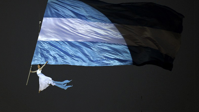 An acrobat performs at Plaza de Mayo square in Buenos Aires on May 25, 2013. (AFP Photo / Alejandro Pagni)
