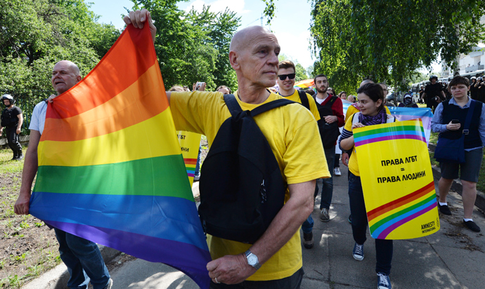 Activists carry a rainbow flag during a Gay Parade in Kiev on May 25, 2013 (AFP Photo / Sergey Supinsky)