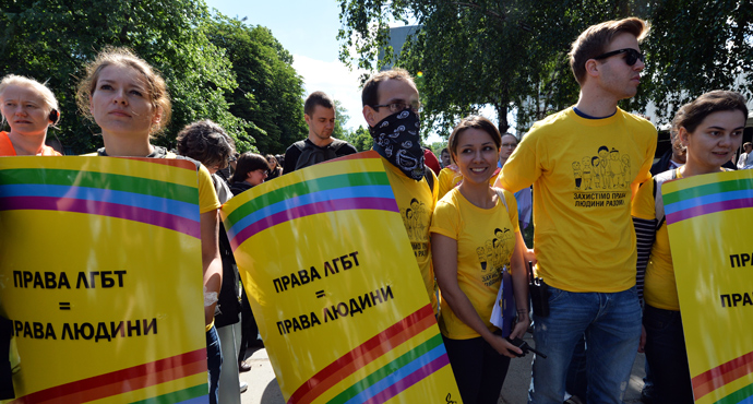 "Activists carry placards reading ""LGB rights are human rights"" during the Gay Parade in Kiev on May 25, 2013 (AFP Photo / Sergey Supinsky)"