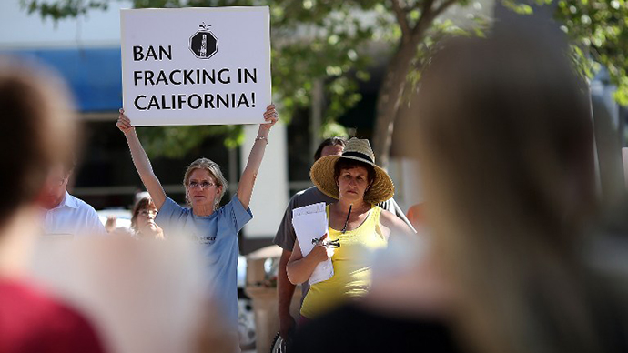 A protestor holds a sign against fracking during a demonstration outside of the California Environmental Protection Agency (EPA) headquarters on July 25, 2012 in Sacramento, California. (AFP Photo / Justin Sullivan)