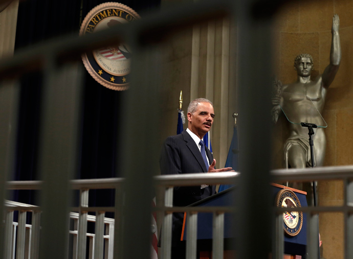 U.S. Attorney General Eric Holder speaks during a special naturalization ceremony at the Department of Justice in Washington May 28, 2013 (Reuters / Kevin Lamarque)