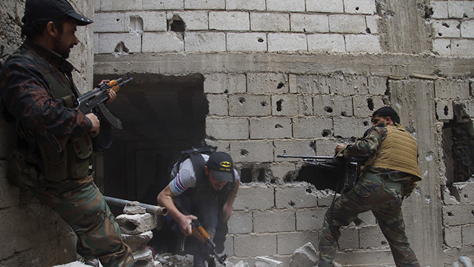 Free Syrian Army fighters lay cover fire after what they say was during clashes with forces loyal to President Bashar al-Assad in Deir al-Zor May 13, 2013. (Reuters)