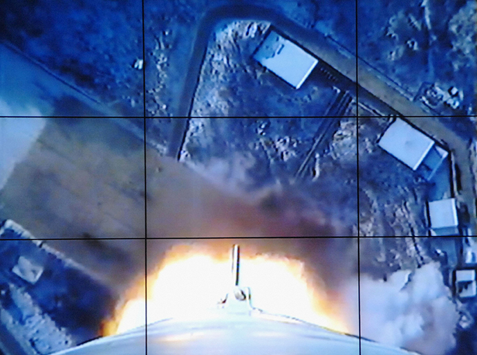 A screen shows a rocket being launched from an onboard camera at the West Sea Satellite Launch Site, at North Korea's satellite control centre in Cholsan county, North Pyongan province, in this photo released by Kyodo December 12, 2012. (Reuters / KCNA)
