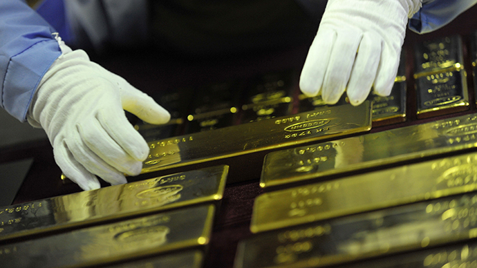 Gold slumps to three-year low, South Africa hit most