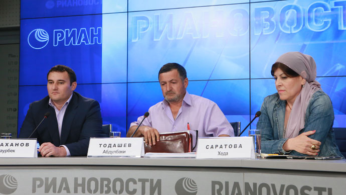 From left: lawyer Zaurbek Sadakhanov of the Moscow Interterritorial Bar Association, Abdulbaki Todashev, the father of Ibraghim Todashev, and human rights activist Kheda Saratova, head of the Objective independent information and analysis agency, at the RIA press conference on May 30, 2013. (RIA Novosti / Alexander Natruskin)