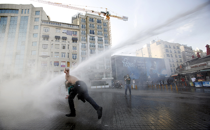 Turkish riot police use water cannon to disperse demonstrators during a protest against the destruction of trees in a park brought about by a pedestrian project, in Taksim Square in central Istanbul May 31, 2013. (Reuters / Murad Sezer)