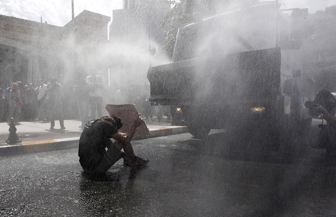Turkish riot police use water cannon to disperse demonstrators during a protest against the destruction of trees in a park brought about by a pedestrian project, in Taksim Square in central Istanbul May 31, 2013. (Reuters / Osman Orsal)
