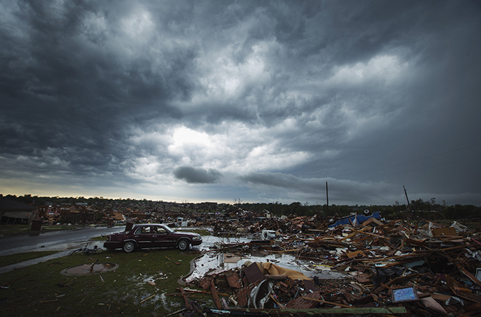 The clouds of a thunderstorm roll over neighborhoods heavily damaged in a tornado in Moore, Oklahoma, May 23, 2013. (Reuters / Lucas Jackson)