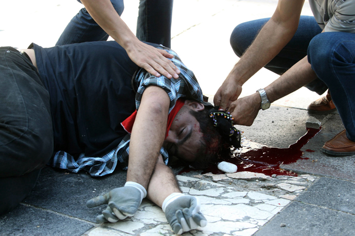 An injured demonstrator lies on the ground on June 1, 2013 during a march to parliament and the prime minister's office in Ankara (AFP Photo / STR)