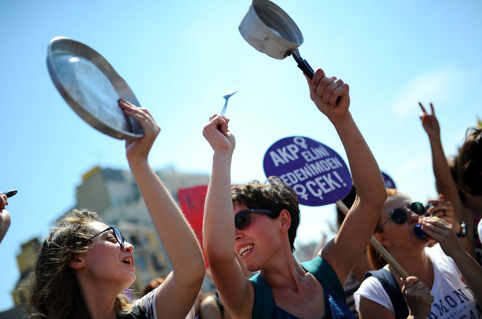 Women chant slogans and dance on Taksim square in Istanbul on June 8, 2013. (AFP Photo / Bulent Kilic)