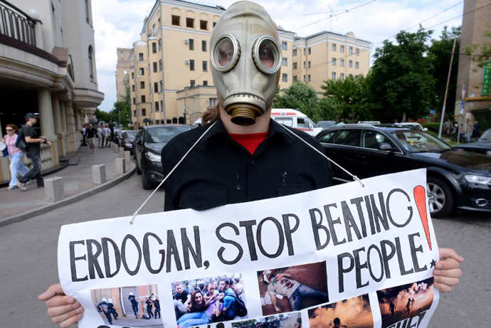 A Russian anarchist activist holds a cardboard during a protest against Turkey's Prime Minister Recep Tayyip Erdogan held near the Turkish embassy in Moscow on June 10, 2013. (AFP Photo / Kirill Kudryavtsev)