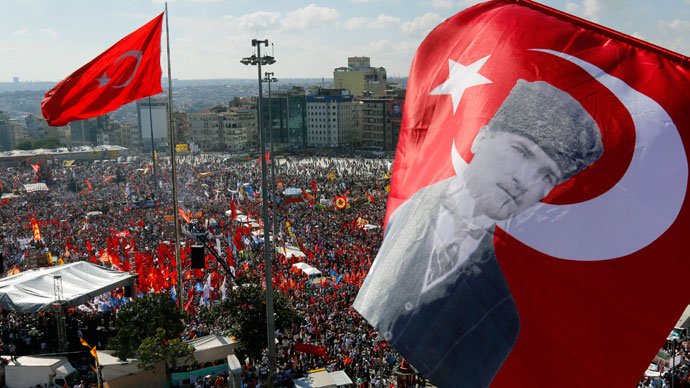 An anti-government protester waves a Turkish flag depicting the founder of modern Turkey Mustafa Kemal Ataturk as thousands of protesters gather in Istanbul's Taksim square June 9, 2013.(Reuters / Yannis Behrakis)