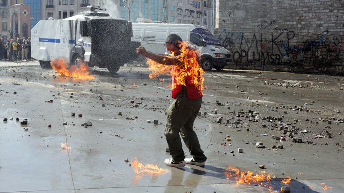 A demonstrator's clothes are set on fire during clashes with riot police in Taksim square on June 11, 2013 (AFP Photo / Oren Ziv)