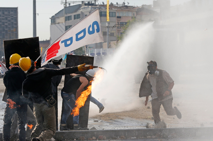 A crowd control vehicle fires a water cannon against protesters during a protest at Taksim Square in Istanbul June 11, 2013 (Reuters / Murad Sezer)