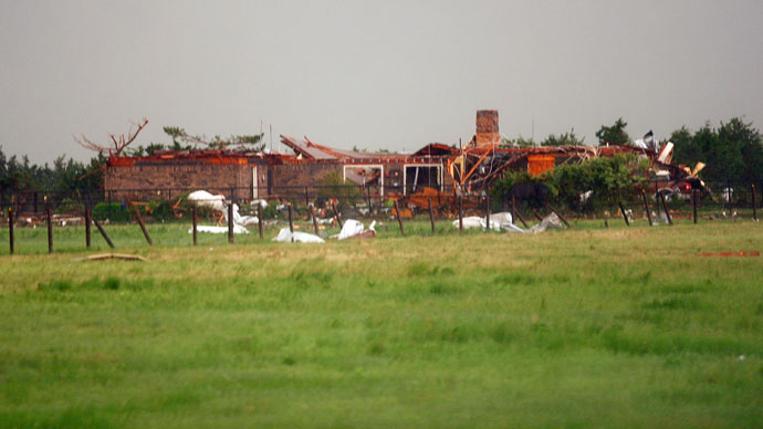 A home, damaged by a tornado, is seen south along Interstate-40 eastbound just east of El Reno, Oklahoma May 31, 2013.(Reuters / Bill Waugh)