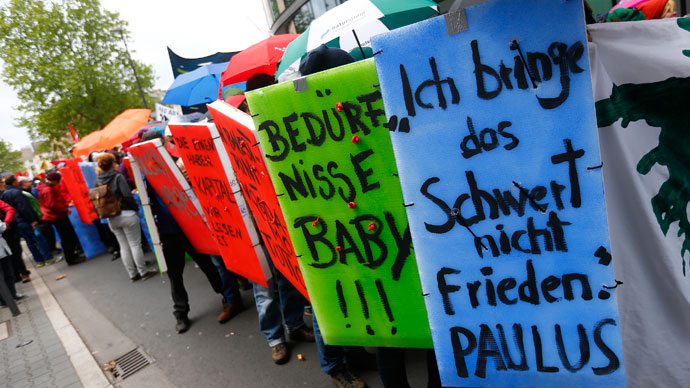 "Protesters hold posters during an anti-capitalism ""Blockupy"" demonstration in Frankfurt June 1, 2013.(Reuters / Kai Pfaffenbach)"