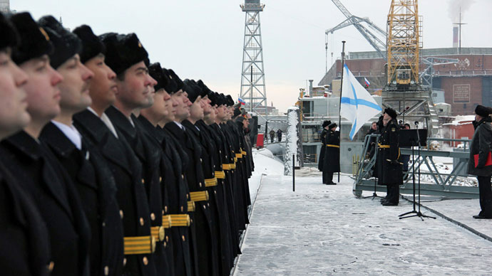 Russian naval officers attending the ceremony of St.Andrew's flag-hoisting at the Yury Dolgoruky nuclear-powered submarine in Severodvinsk.(RIA Novosti / Alexander Petrov)