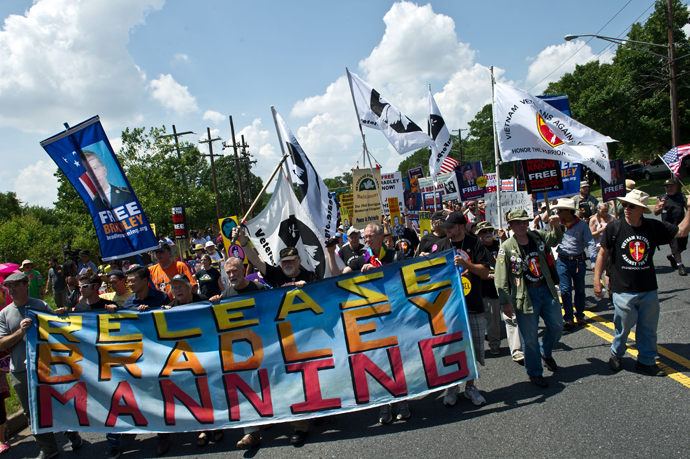 People march on June 1, 2013 during a demonstration in support of Wikileaks whistleblower, US Army Private Bradley Manning at Fort Meade in Maryland, where Manning's court martial will begin on June 3 (AFP Photo / Nicholas Kamm)