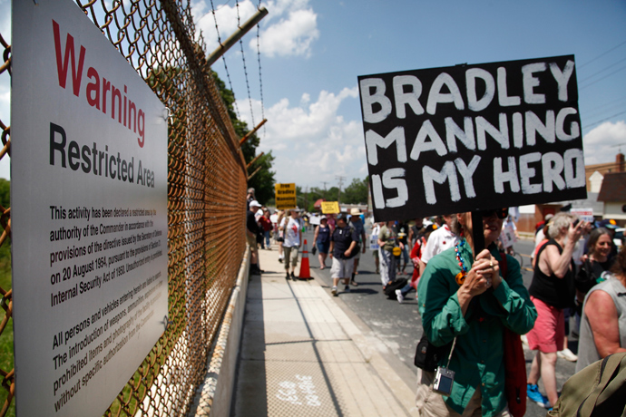 Protesters march past a 'Restricted Area' sign as they rally to call for the release of jailed U.S. Army Private Bradley Manning, a central figure in the Wikileaks case, outside the fence at Fort Meade, Maryland, June 1, 2013 (Reuters / Jonathan Ernst)