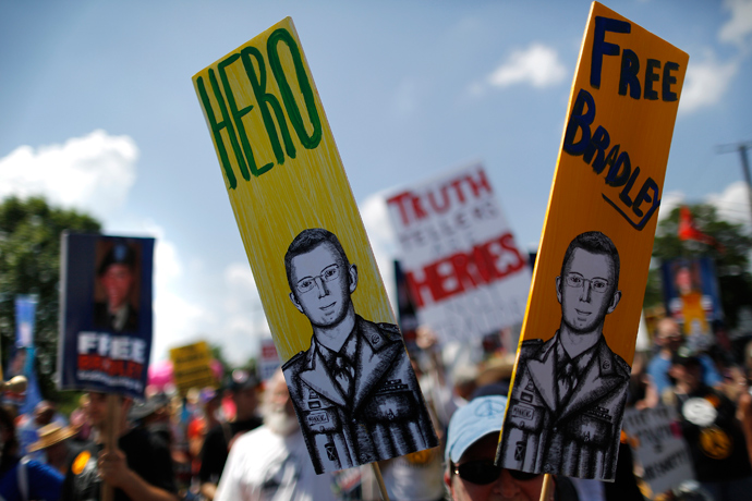 A protester carries a sign reading 'Hero' with a picture of jailed U.S. Army Private Bradley Manning, a central figure in the Wikileaks case, as marchers rally to call for his release, outside the gates at Fort Meade, Maryland, June 1, 2013 (Reuters / Jonathan Ernst)