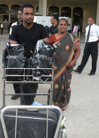Failed Sri Lankan asylum seekers deported from Britain exit the airport following their arrival in Colombo (AFP Photo / STR)