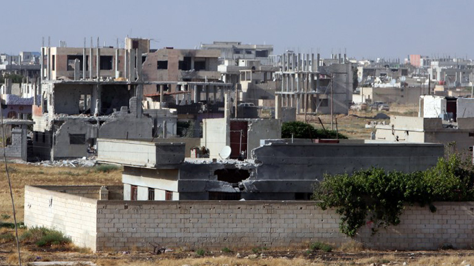 A partial view of the city of Qusayr, in Syria's central Homs province, as the Syrian army forces battle opposition fighters, on May 25, 2013. (AFP Photo)
