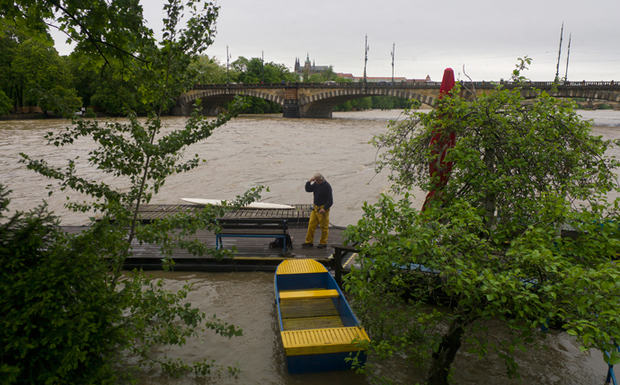 A man stands on a footbridge in the flooded Vltava river on June 2, 2013 in Prague (AFP Photo / Michael Cizek)