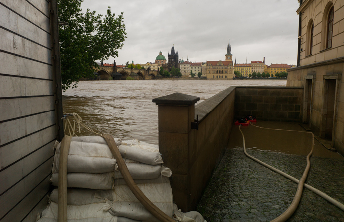 A metal anti-flood barriers and sand bags are seen as Vltava river is flooded on June 02, 2013 in Prague (AFP Photo / Michael Cizek)