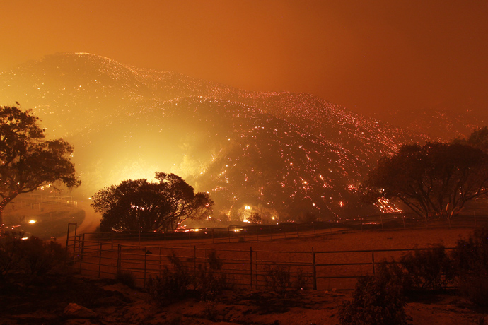 The landscape glows immediately after the main fire front swept over in a fast run toward Lake Hughes on June 1, 2013 south of Lake Hughes, California (AFP Photo / David McNew)