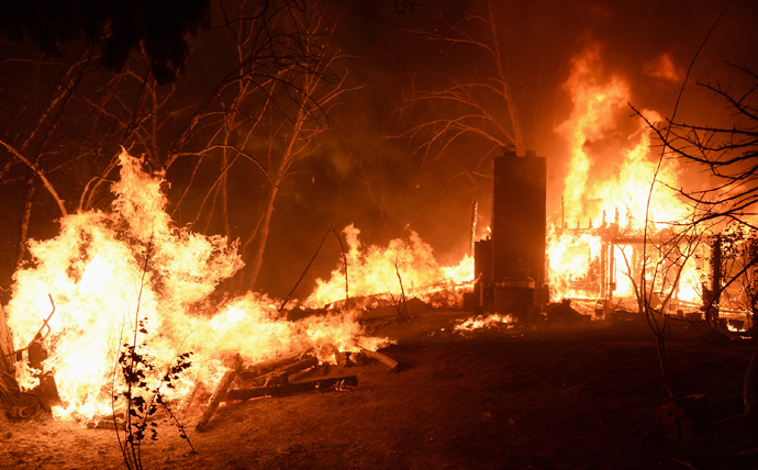 Fire engulfs a house as firefighters battle the Powerhouse wildfire at the Angeles National Forest, with the fire now having destroyed several homes near the Lake Hughes area in California June 1, 2013