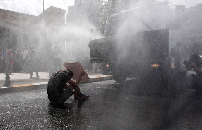 Turkish riot police use water cannon to disperse demonstrators during a protest against the destruction of trees in a park brought about by a pedestrian project, in Taksim Square in central Istanbul May 31, 2013 (Reuters / Osman Orsal)