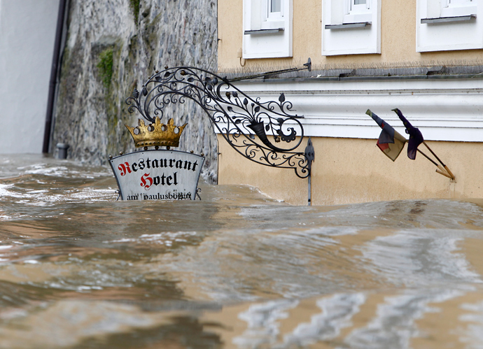 The sign above the door of restaurant and hotel 'Am Paulusbogen' is partially submerged in the flooded centre of the Bavarian town of Passau, about 200 km north-east of Munich June 3, 2013 (Reuters / Michaela Rehle)
