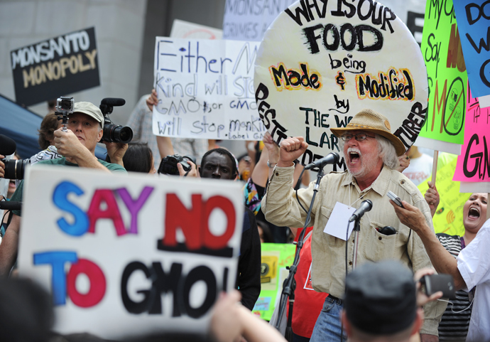 David King, founder and chairman of the Seed Library of Los Angeles, speaks to activists during a protest against agribusiness giant Monsanto in Los Angeles on May 25, 2013 (AFP Photo / Robyn Beck)