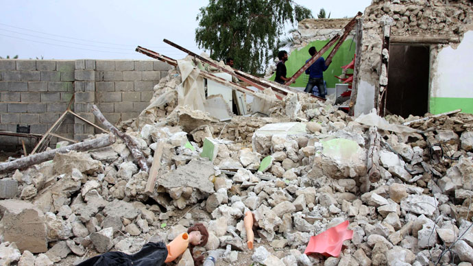 A doll lies on the rubble of a destroyed house as Iranian residents inspect the damage in the town of Shonbeh, southeast of Bushehr, on April 10, 2013.(AFP Photo / STR)