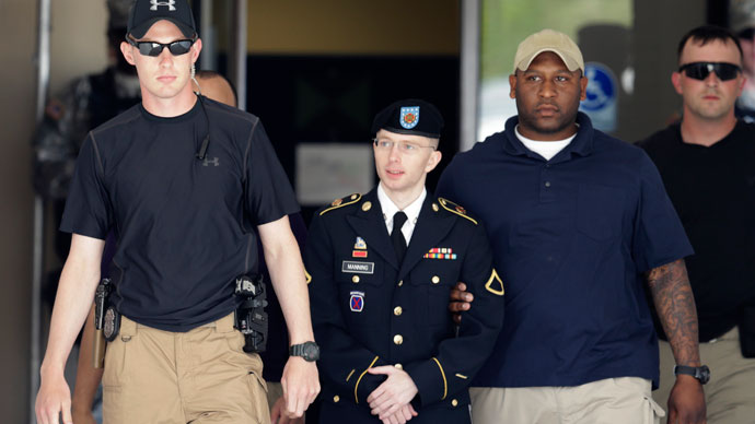 U.S. Army Private First Class Bradley Manning (2nd L) departs after day two of his court-martial at Fort Meade, Maryland June 4, 2013.(Reuters / Gary Cameron)