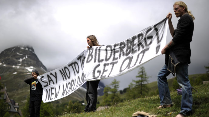 Activists protest on June 9, 2011 in front of the Suvretta House five-star hotel in the chic Swiss ski station of St Moritz, where the Bilderberg Group is holding its annual meeting.(AFP Photo / Fabrice Coffrini)