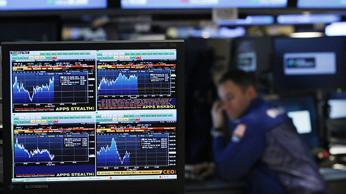 A Bloomberg terminal displays news while traders work on the floor of the New York Stock Exchange, May 16, 2013. (Reuters / Brendan McDermid)