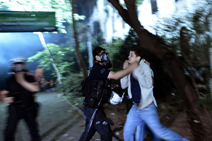 A riot policeman detains a demonstrator in Istanbul on June 4, 2013. (AFP Photo / Aris Messinis)