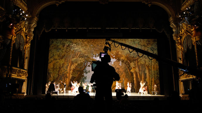 A cameraman films members of the Mariinsky theatre performing during a rehearsal for filming in St.Petersburg June 2, 2013.(Reuters / Alexander Demianchuk)