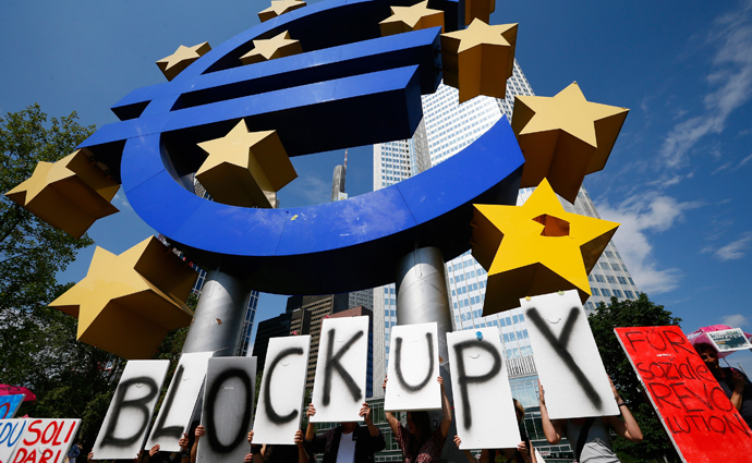 Protestors demonstrate in front of the headquarters of the European Central Bank in Frankfurt, June 8, 2013. (Reuters / Ralph Orlowski)