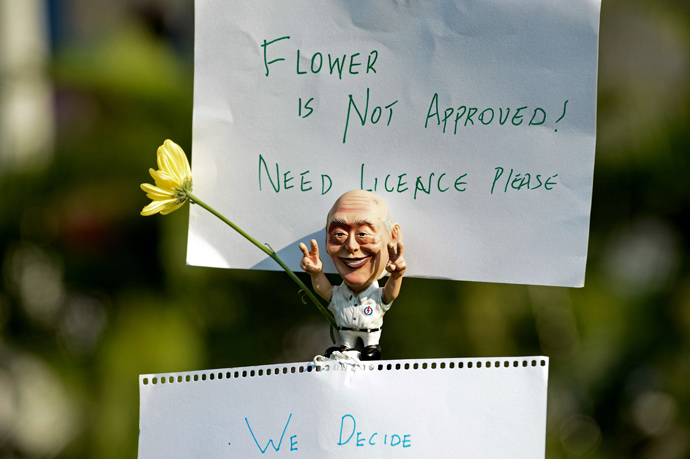 A Caricature of former Singapore prime minister Lee Kuan Yew is displayed during a rally at a free-speech park called Speakers' Corner in Singapore on June 8, 2013 (AFP Photo / Roslan Rahman)