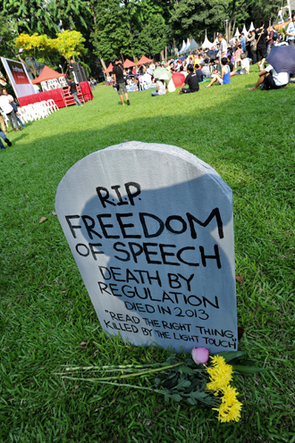 A mock tombstone is displayed during a rally at a free-speech park called Speakers' Corner in Singapore on June 8, 2013 (AFP Photo / Roslan Rahman)