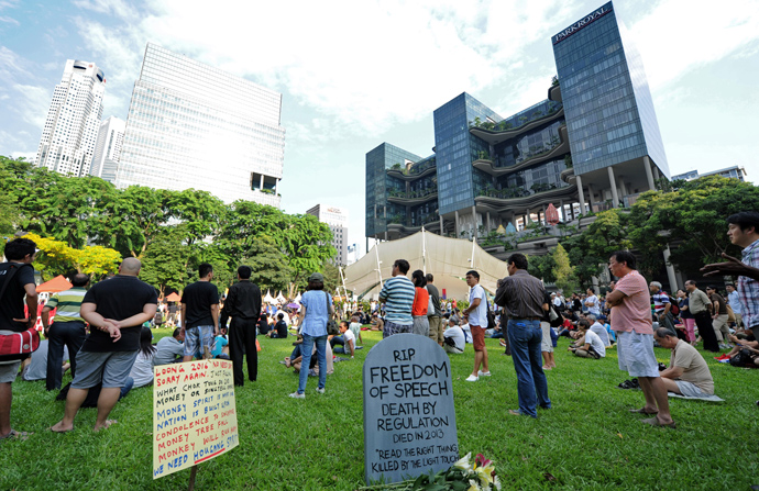 People gather to listen to bloggers speeches during a rally at a free-speech park called Speakers' Corner in Singapore on June 8, 2013 (AFP Photo / Roslan Rahman)