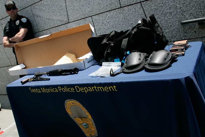 Weapons and gear used by the shooting suspect in Friday's crime spree is put on display for the media by the Santa Monica Police Department in Santa Monica, California, June 8, 2013 (Reuters / Jonathan Alcorn)