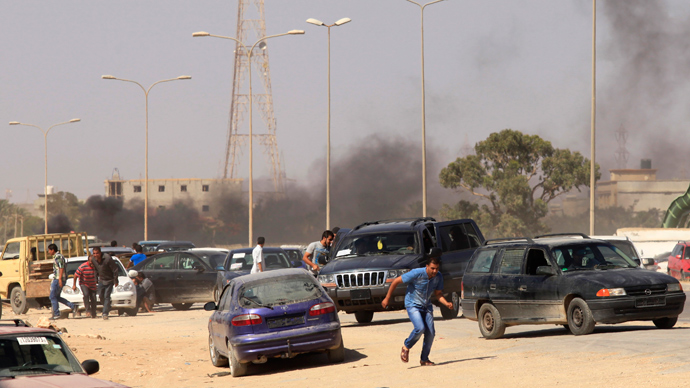 Protesters run after an attack on a Libyan militia, the Libya Shield brigade, headquarters in Benghazi, June 8, 2013 (Reuters / Esam Al-Fetori)