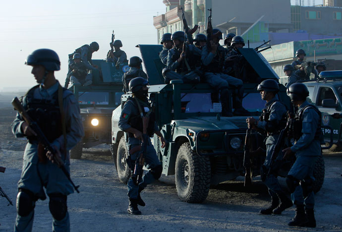 Afghan police arrive at the site of an attack in Kabul June 10, 2013.(Reuters / Omar Sobhani)