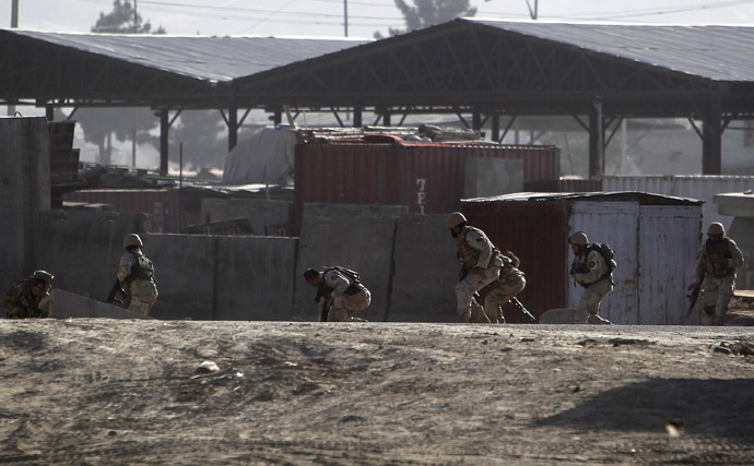Afghan security forces take their position at the site of an attack in Kabul June 10, 2013. (Reuters/Omar Sobhani)